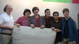 "Focus Media member producers of ""Humorama"" receive check at ACMi's Studio B from Just-A-Minute Festival founder Don Daniels. From left to right (after Mr. Daniels) they are: Mike, Brendan, Noel, Adrian, and Lucas (listed above photo)."
